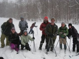 Wilderness Voyageurs staff and friends posing for a group shot during a Saturday afternoon ski.