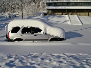Kasia's car buried in the snow in front of the Wilderness Voyageurs bath house!