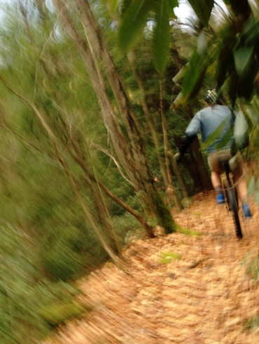 Unicycling down a trail